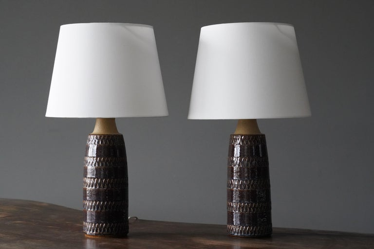 A pair of table lamps produced by Søholm Keramik, located on the island of Bornholm in Denmark. In a highly artistic brown / beige glaze with hints of blue.   Lampshades are attached for reference and are not included in the purchase. Dimensions
