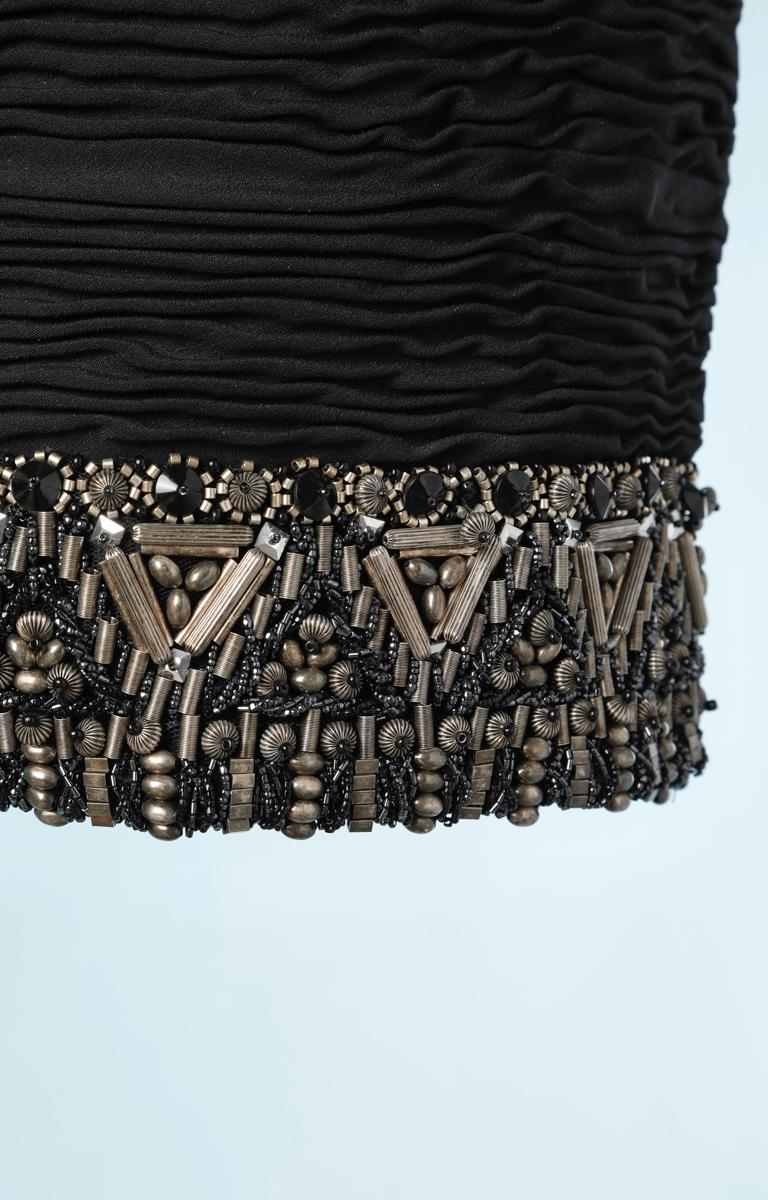 Short silk skirt pleated and embroidered with black beads and silver metal beads Atelier Versace label, back zip. Size: 34/36 French model 8930287