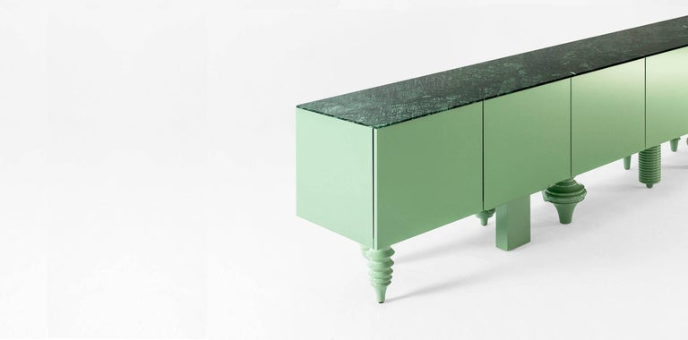 Containers and frontals are of a 19mm DM and shelves are of 25mm DM. Matte lacquered on the inside and back. Doors and sides are lacquered in a high-gloss finish. Solid turned alder-wood legs with a gloss lacquered finish in the same color as the