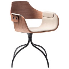 Swivel walnut desk chair upholstered in fabric