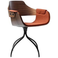 Upholstered swivel chair in walnut designed by Jaime Hayon