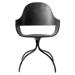 Chair in black stained ash and swivel base