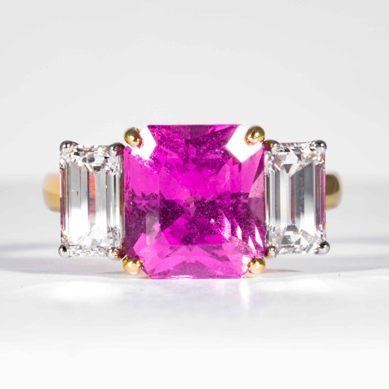 This sapphire and diamond 3-stone ring is offered by Shreve, Crump & Low. This radiant cut pink sapphire is custom set in a handcrafted Shreve, Crump & Low platinum and 18k yellow gold 3-stone ring, consisting of 1 vibrant radiant cut pink sapphire