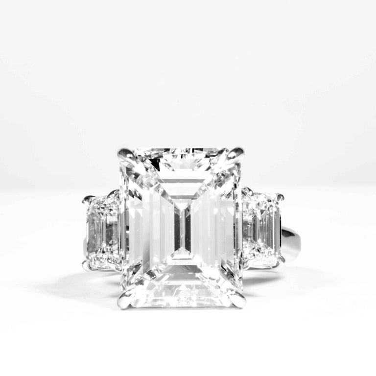 This 3-Stone diamond ring is offered by Shreve, Crump & Low. This 10.75 carat GIA Certified K VS2 emerald cut diamond measuring 14.35 x 11.08 x 7.43 mm is custom set in a handcrafted Shreve, Crump & Low platinum 3-stone ring. The 10.75 carat emerald