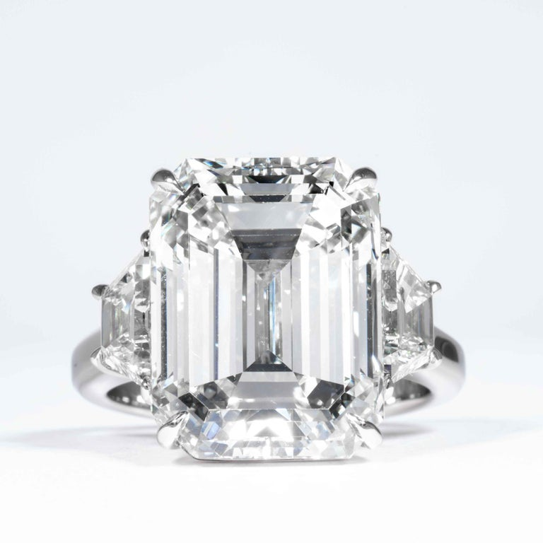 This 3-Stone diamond ring is offered by Shreve, Crump & Low. This 13.26 carat GIA Certified K VS2 emerald cut diamond measuring 15.30 x 11.64 x 8.31 mm is custom set in a handcrafted Shreve, Crump & Low platinum 3-stone ring. The 13.26 carat emerald