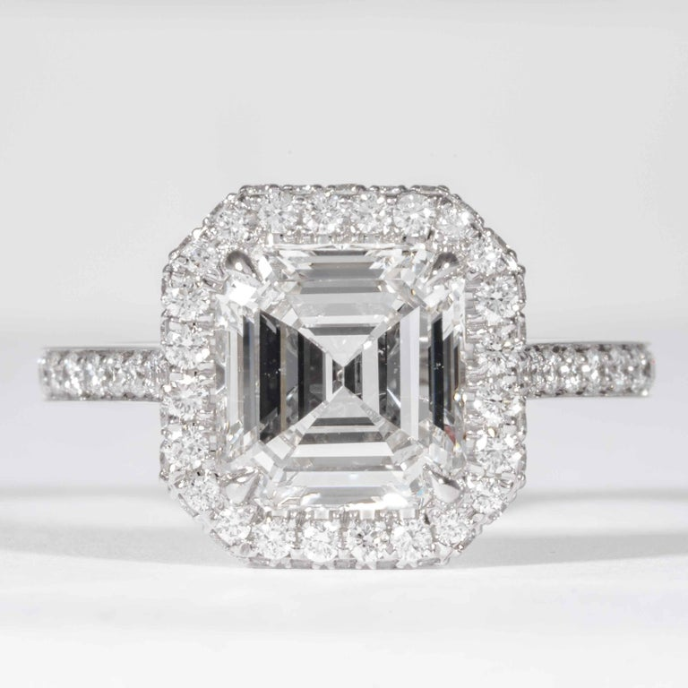 This diamond ring is offered by Shreve, Crump & Low. This 2.74 carat GIA certified E SI1 emerald cut diamond is custom set in a handcrafted Shreve, Crump & Low platinum diamond halo ring. The 2.74 carat Emerald cut is surrounded by 88 round diamonds