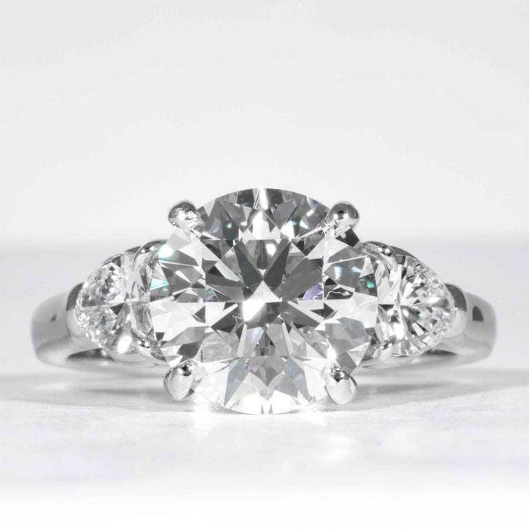 This elegant and classic diamond ring is offered by Shreve, Crump & Low. This 3.23 carat GIA Certified E VVS2 round brillinat cut diamond measuring 9.42 - 9.46 x 5.88 mm is custom set in a handcrafted Shreve, Crump & Low platinum 3-stone ring. The