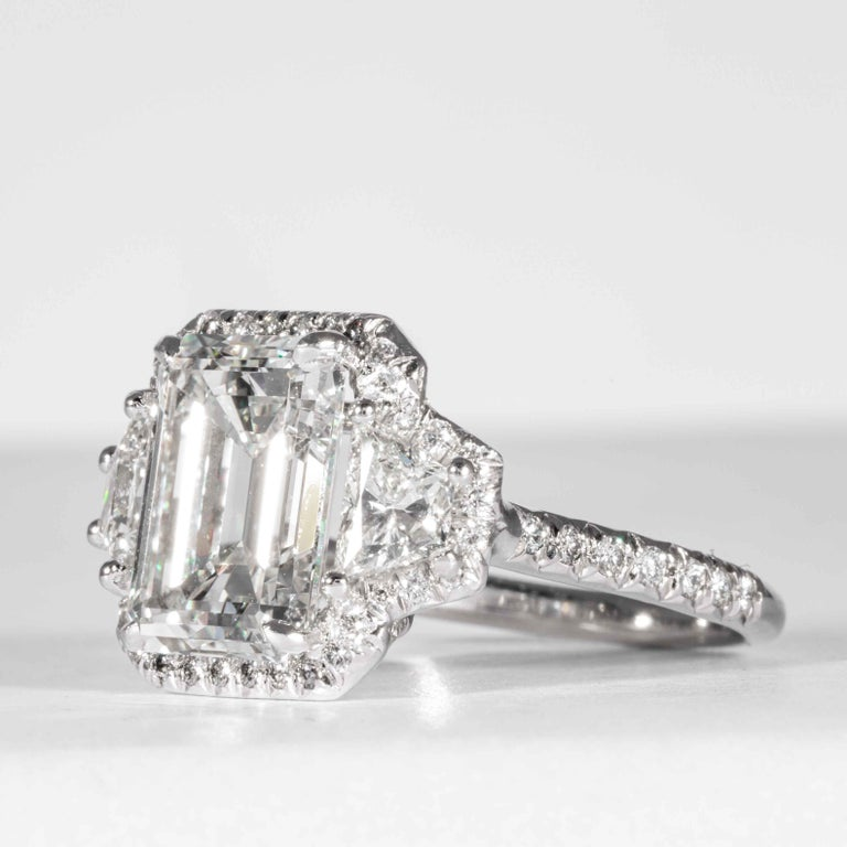 This diamond ring is offered by Shreve, Crump & Low. This 4.01 carat GIA Certified G VVS2 emerald cut diamond is custom set in a handcrafted Shreve, Crump & Low platinum 3-stone ring. The 4.01 carat emerald cut center diamond is accented by two 2