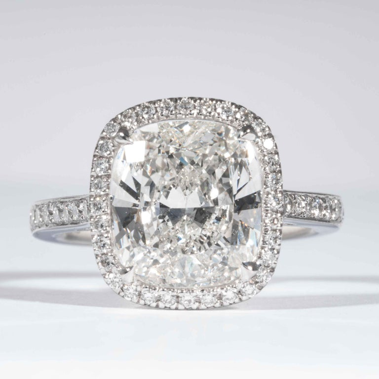 This diamond ring is offered by Shreve, Crump & Low. This 4.01 carat GIA Certified I VVS2 cushion cut diamond measuring 10.59 x 9.48 x 5.14 mm is custom set in a handcrafted Shreve, Crump & Low platinum ring. The 4.01 carat center diamond is