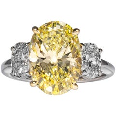 Shreve, Crump & Low GIA Certified 4.55 Carat Fancy Yellow Oval Diamond Ring