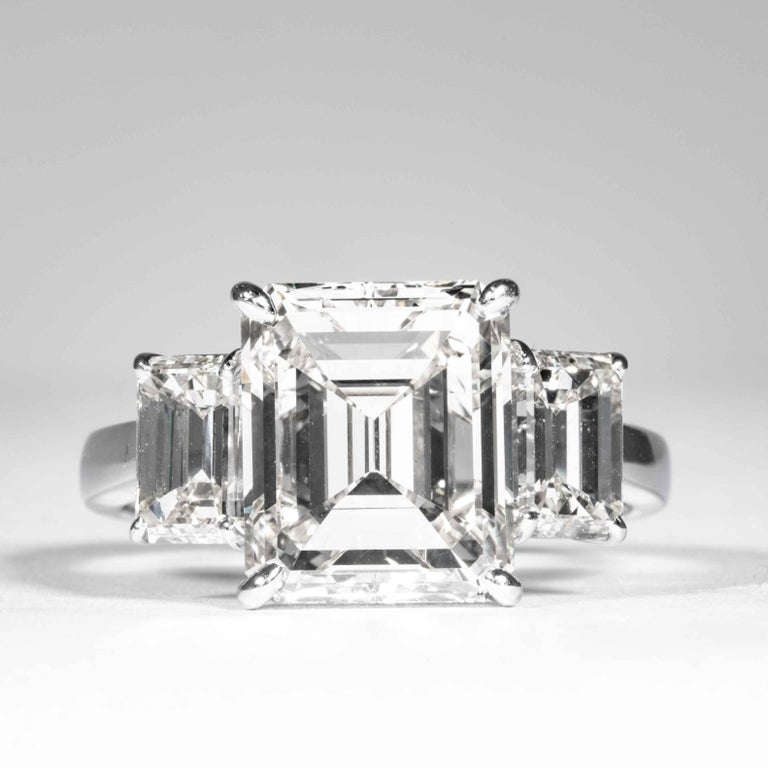 This 3-Stone diamond ring is offered by Shreve, Crump & Low. This 5.05 carat GIA Certified J VVS2 emerald cut diamond measuring 10.85 x 9.08 x 5.72 mm is custom set in a handcrafted Shreve, Crump & Low platinum 3-stone ring. The 5.05 carat emerald