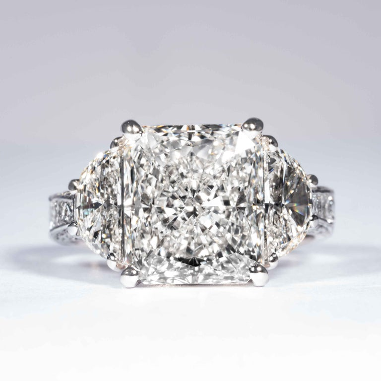 This radiant cut diamond ring is offered by Shreve, Crump & Low. This 5.07 carat GIA Certified I VS2 radiant cut diamond measuring 11.06 x 9.62 x 5.67 mm is custom set in a handcrafted Shreve, Crump & Low platinum 3-stone ring. The 5.07 carat