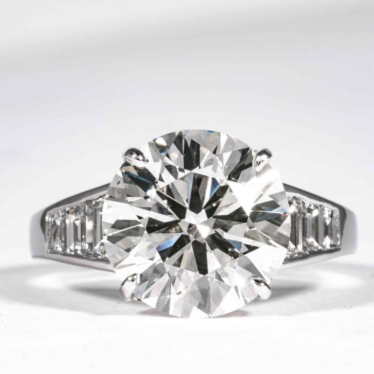 This elegant and classic diamond ring is offered by Shreve, Crump & Low. This 5.60 carat GIA certified J SI1 round brilliant cut diamond measuring 11.60 x 11.67 x 6.88mm is custom set in a handcrafted Shreve, Crump & Low Platinum and Diamond ring.