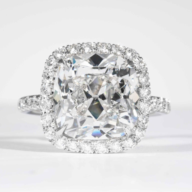 This diamond ring is offered by Shreve, Crump & Low. This 7.01 carat GIA Certified G SI2 cushion cut diamond measuring 11.08 x 11.02 x 7.41 mm is custom set in a handcrafted Shreve, Crump & Low 18kt White Gold Halo ring. The 7.01 carat center