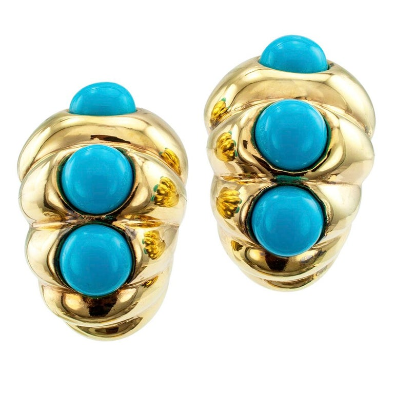 "Turquoise and gold tapered shrimp hoop earrings circa 1980. The designs are large enough to qualify for ""Jumbo Shrimp"" designation. Check out the dimensions below. Each is decorated with a trio of slightly graduated turquoise cabochons, mounted in"