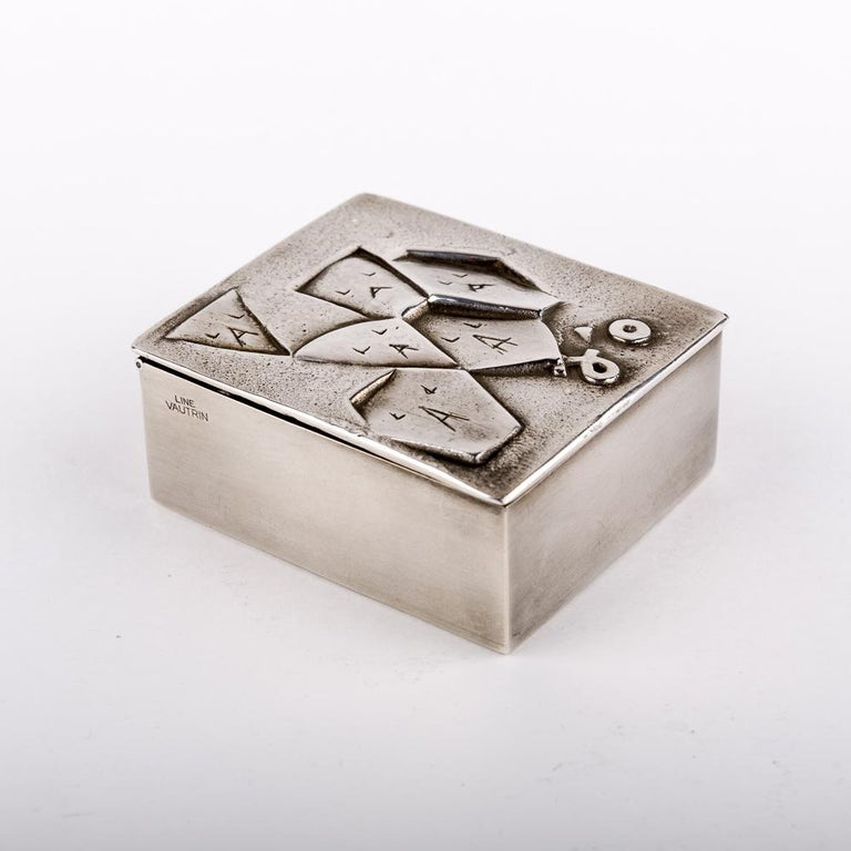 A rare silvered bronze box by French designer and decorator Line Vautrin. It's a rebus box which is named Si Face à Elle j'osais (if facing here I dared) There is six faces (Si face), the markings on the faces are A and L (à elle) J'o. At the