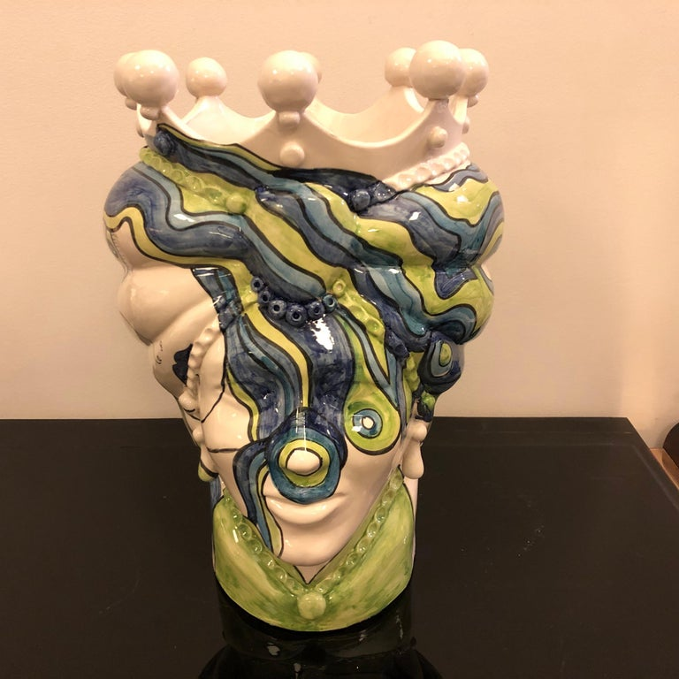 It's an unique piece made by a Sicilian young artist, it's in white clay and fully hand painted, made in Caltagirone, a little town near Catania. Signed 1/1 m.r. on the bottom.