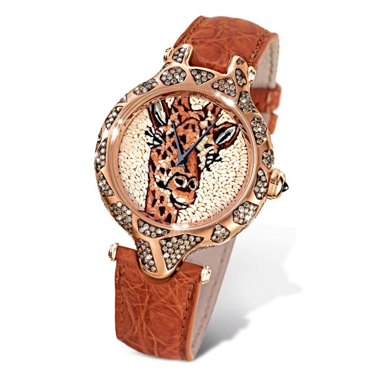 Micromosaic watch with gold case, Swiss Made, Manual Movement. Alligator strap.   Limited edition, 10 pieces only.   Piece entirely handmade by micromosaic artists.   Comes with life guarantee    All items with exotic leather straps will require 2