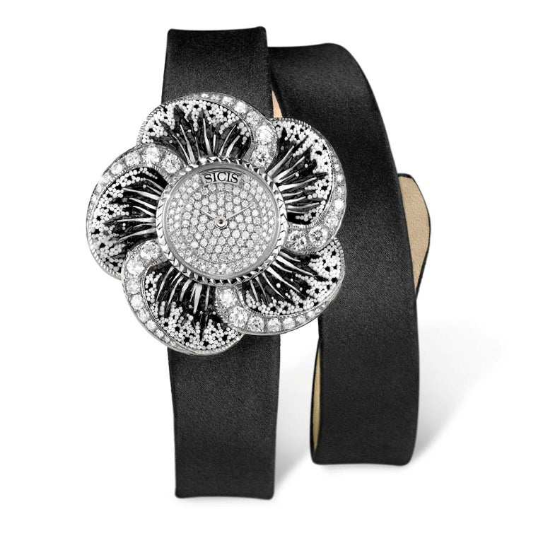 Micromosaic watch in white gold 18 kt and diamonds. Satin strap. Swiss quartz movement.  Limited edition of 10 pieces.  Gold Case  NanoMosaic   Sapphire Glass   Quartz Movement (Swiss Made) Gold 750‰  White Diamonds    For any questions please