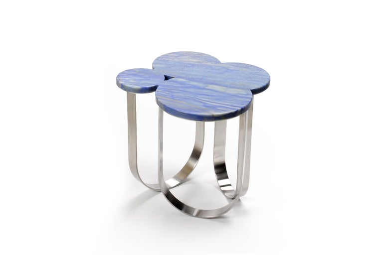 The 'Cloud' is a spectacular side table with structure in mirror polished stainless steel and top in Azul Macaubas quartzite. Side table dimension: L 46 x W 44 x H 40cm. The mirror-like finishing of the stainless steel creates different perceptions