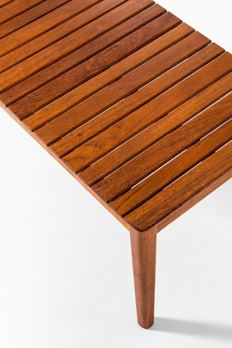 Rare side table or bench in solid teak. Produced by Alberts in Tibro, Sweden.