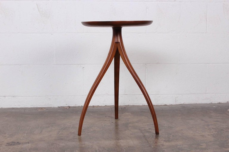 A walnut side table designed by Edward Wormley for Dunbar.