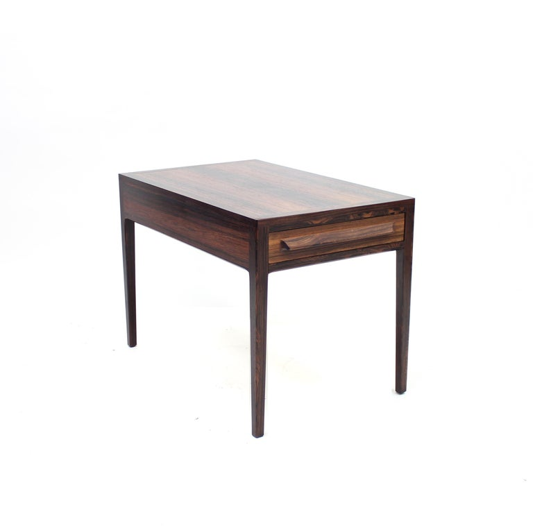 Rosewood side table from the 1960s by Norwegian manufacturer O.P. Rykken & Co. Front side with a drawer. Can also be used as a nightstand. Good vintage condition with normal ware consistent with age and use including a few scratches and marks. Tiny