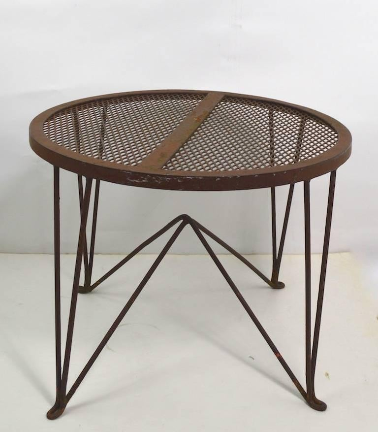 Architectural side table manufactured by Salterini, design attributed to Tempestini. Metal mesh top with wrought iron rod base, currently in original brown paint finish (shows wear). We offer custom powder coating if you prefer a more polished