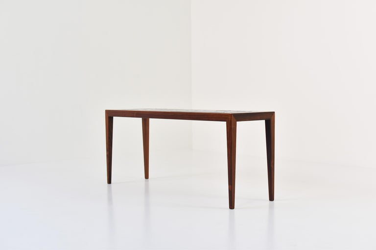 """Side table by Severin Hansen for Haslev, Denmark, 1965. This table is made out of rosewood and has ceramic tiles in the top from the """"Tenera"""" series by Nils Thorsson for Royal Copenhagen. Labeled. Clean lines. Mint condition!"""
