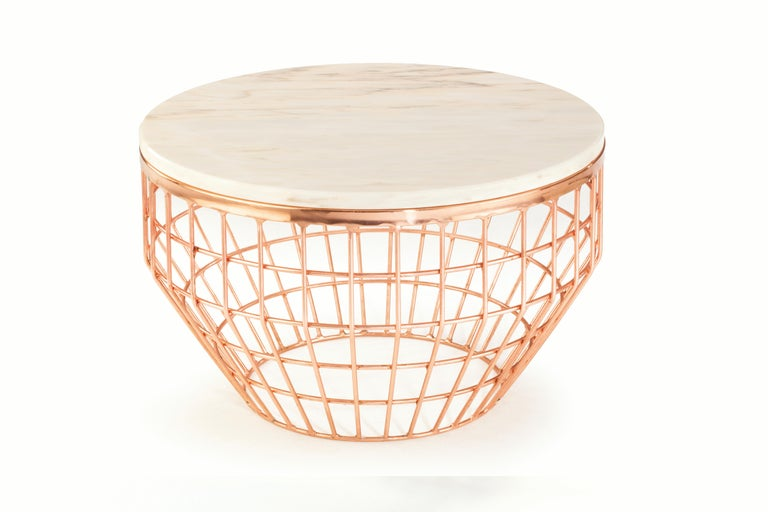 Sleek and light, these centre tables are original and fresh. The brass or copper base and the table top available in marble allow different combinations to suit every color scheme. Made to Order.   For sales with delivery address within European