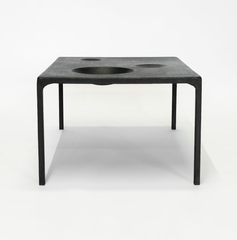 """Side table no. 11 by JM Szymanski Dimensions: L 26"""" x W 26"""" x H 20"""" Materials: Blackened waxed steel  This modern hand carved side table with geometric voids. Each table is made to our client's needs and specifications.  Jake Szymanski lives"""