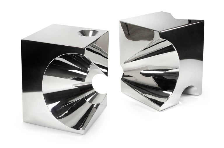 Side table get lost! Made of mirror polished stainless steel. Side table dimension: L 45, W 45, H 57cm. This side table can be used as a stool. Peter Marino selected an sculptural bench of the Get Lost! Family for the new flagship store Dior in