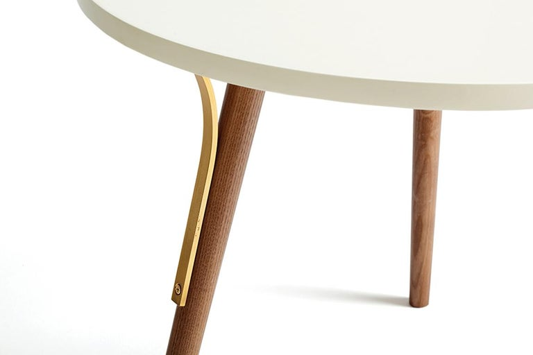 Inspired by the Scandinavian design, these tables are minimalist yet detailed. Sensible combination of lacquer and hardwood feet, along with brass details, results in a very elegant piece. Find your own way of living. Made to Order.   For sales with