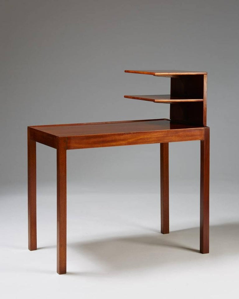 Side table with bookshelf designed by Josef Frank for Svenskt Tenn, Sweden, 1950s.  Mahogany.  Literature: Josef Frank Möbelformgivare, Kristina Wängberg-Eriksson and Jan Christer Eriksson, similar p. K90 and K92.