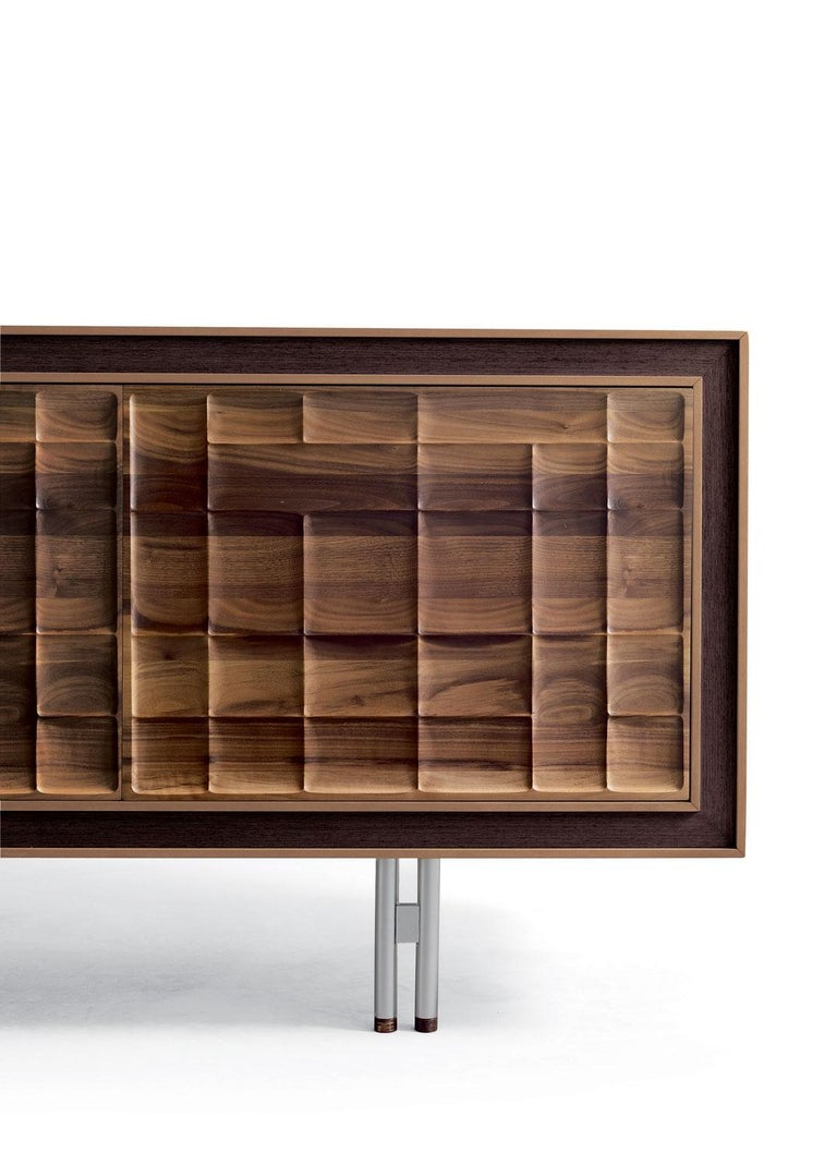 Sideboard in solid walnut with three carved doors, oil finish, feet in still and copper,