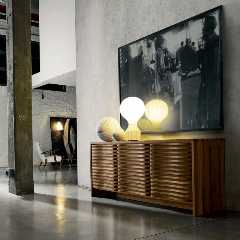 Sideboard with three doors made in solid walnut and wengé, oil natural finish, made in Italy Internal glass sheves.