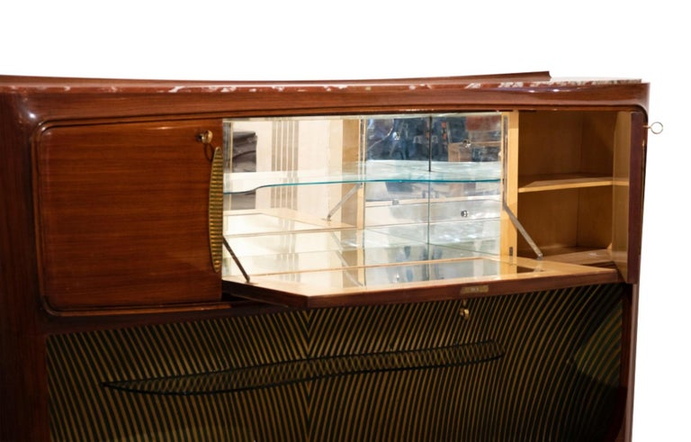 Sideboard and dry bar is a design furniture realized by Vittorio Dassi (1893-1973) in the 1950s.  Wood, brass, metal, marble and glass.   Dimensions: cm 125 x 40 x 210.  Very good condition.  The creations of Vittorio Dassi (1893-1973), made