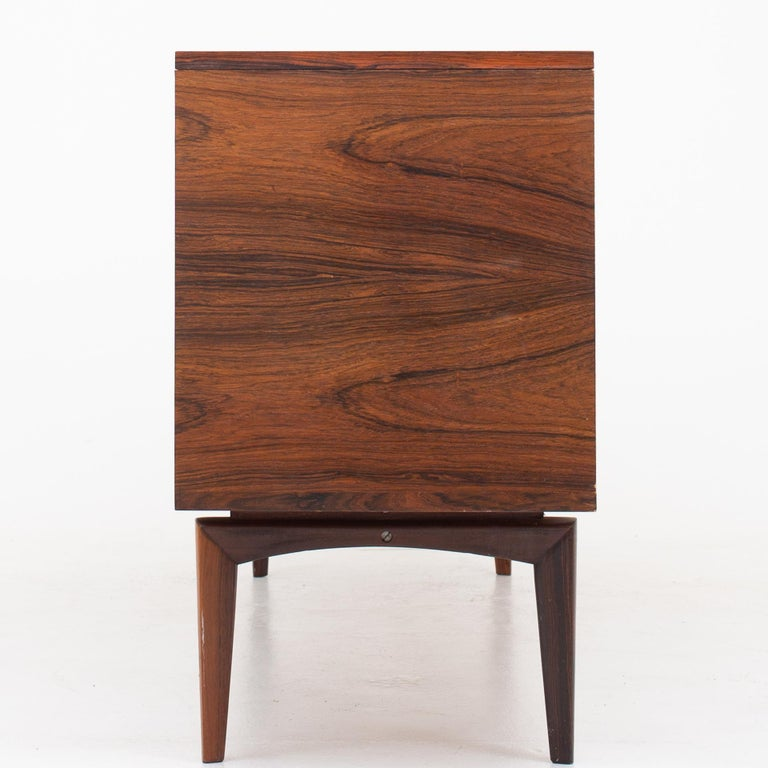Sideboard in rosewood with tambour and drawers. Maker Bramin Møbelfabrik.