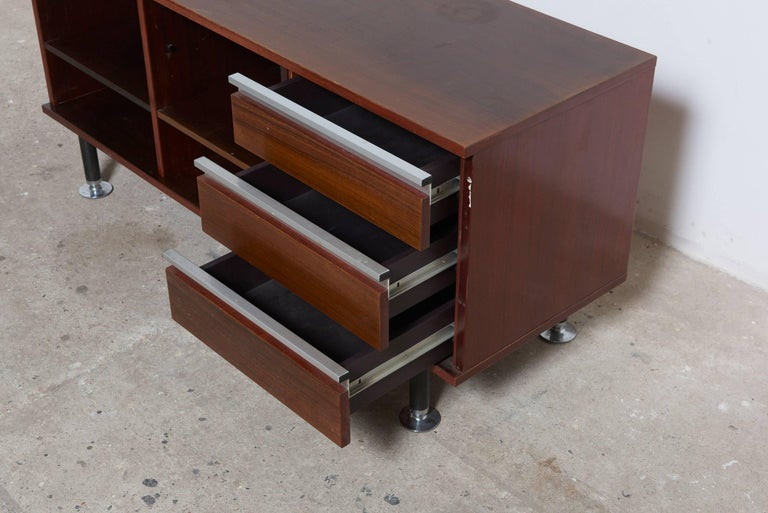 A MIM sideboard with aluminium handles is a perfect example of this creating and a beautiful detail designed by Ico Paresi. Two compartments with one shelve and one with three drawers. Original good vintage condition.