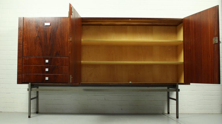 Beautiful credenza by famous designer Louis van Teeffelen for WéBé, 1960s. This Minimalist rosewood sideboard is often attributed to designer Alfred Hendrickx for Belform, but is actually model 317 by Louis van Teeffelen. The cabinet has three