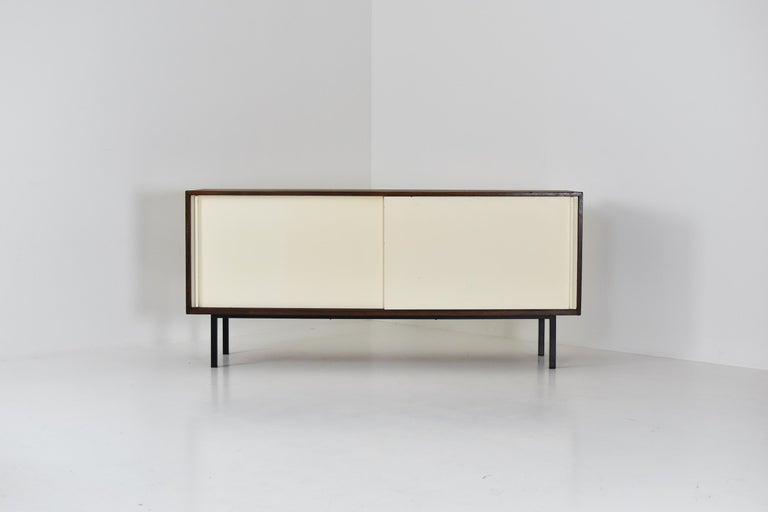 Modernist sideboard designed by Martin Visser and Jos Manders for 't Spectrum, The Netherlands, 1958. This is Model No. 'KW87' made out of wenge, white painted sliding doors and a black lacquered steel frame. The doors covering a series of three