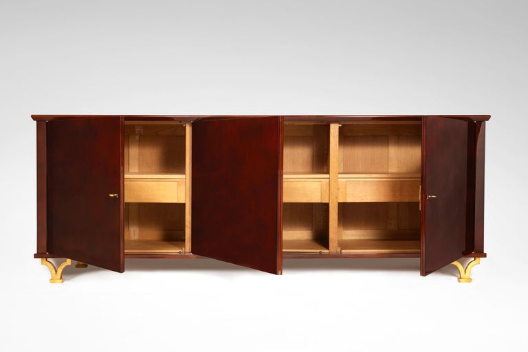 Lacquered sideboard in oak, wood and gilt-wrought iron designed by Gilbert Poillerat.