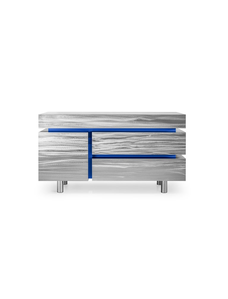 Sideboard Gerrit CS1 by NOOM Dimensions: 50cm x 140 cm x H 80 cm  Materials: Stainless Steel. MDF.   While looking at these tables for the first time, you get the feeling that the basic element of the interior is clean, familiar, and