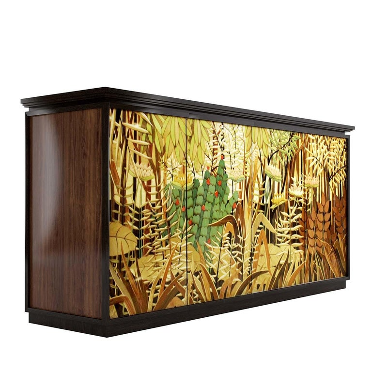 A sculptural work of art defined by meticulous craftsmanship, this sideboard boasts impeccable marquetry covering the front doors inspired by French artist Henri Rosseau's art. Part of the Jungle Collection and exuding an Art Deco allure, this piece