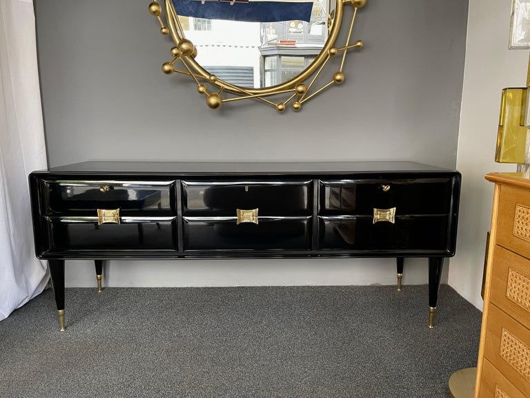 Sideboard credenza buffet or chest of drawers commode in black lacquered wood, brass feet and handle. Also available the nightstands side end tables. Famous design like Gio Ponti, Ico Parisi.