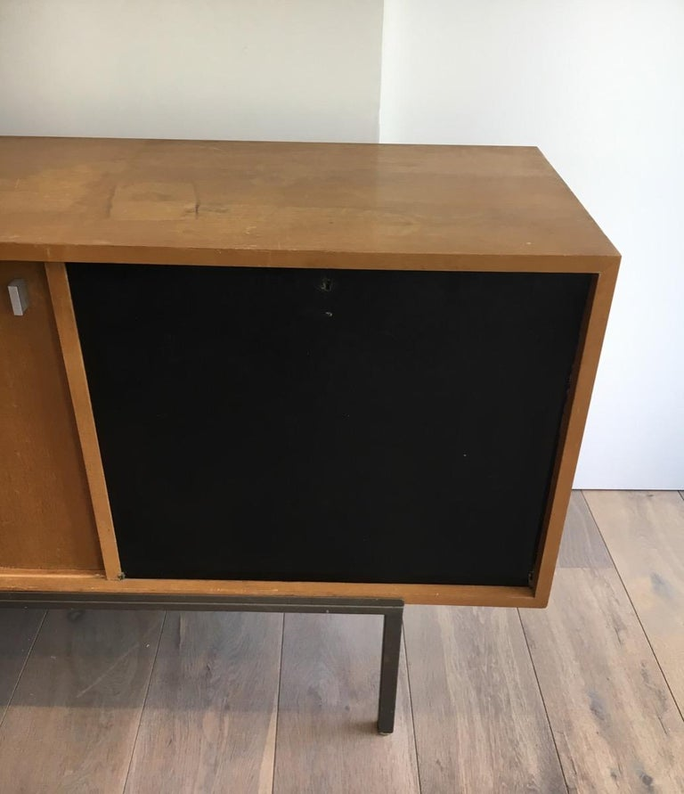 Mid-Century Modern Sideboard with Two Sliding Doors and a Bar and a Metal Base, circa 1950 For Sale