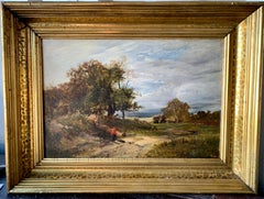 19th century English landscape with a figure on a pathway and stormy sky