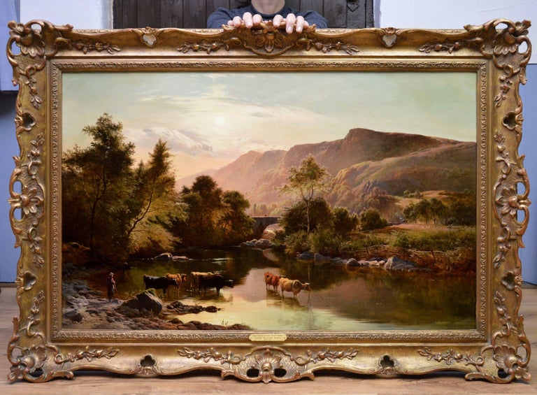 This is a very fine large 19th century oil on canvas depicting cattle watering at the riverside in an extensive mountainous summer landscape 'Near Betwys-y-Coed, North Wales' by the important Victorian landscape painter Sidney Richard Percy