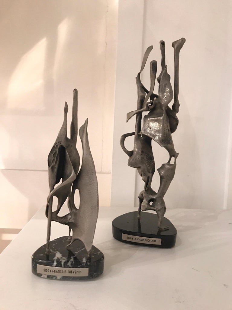 Sido and Francois Thevenin metal abstract sculptures, 1972, France Hand signed 1972 Mounted on marble bases Small: 23 cm height 10 cm diameter.