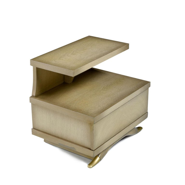 This handsome pair of mahogany Art Deco nightstands were made by Sieling Modern, vintage 1950s. Each nightstand had a single, spacious drawer at the base. The angular profile of the two-tier nightstand is softened by the elegant feet. Look to the